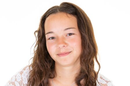 Portrait of young beautiful girl smiling looking at camera over white background
