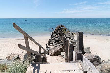 breakwater and wooden path access in sand dune beach in Vendee Noirmoutier Island France
