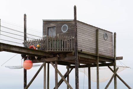 Typical wooden fishing huts on stilts in atlantic ocean near La Rochelle France