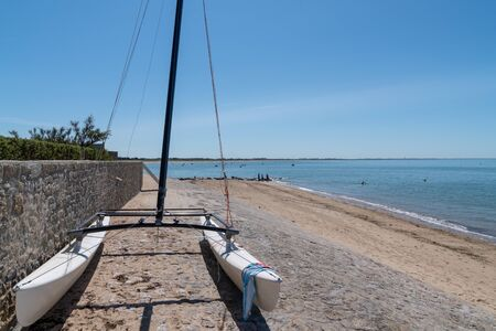 boat parked on the beach at Noirmoutier beach in Vendee France