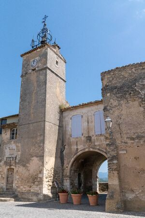 old village of the Provence Town hall Ménerbes on a hill department Vaucluse in Luberon mountains Provence