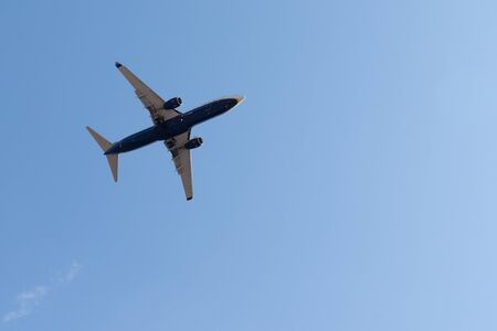 Airplane flying in the blue sky with copy space
