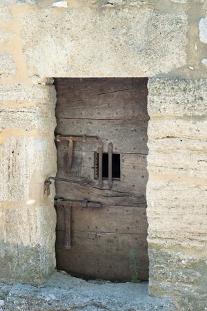 Medieval Jail door on an ancient fortress  in village Ménerbes in Provence France