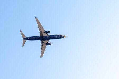 plane flies airplane in blue sky summer