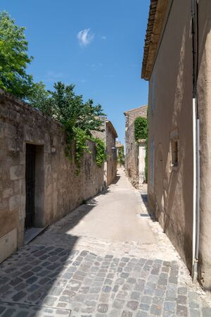 Narrow alley small street in Menerbes village in Luberon France