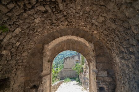 medieval arch stone in alley village of ménerbes in Luberon Provence France Stock Photo - 130160609