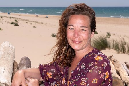 forty year old woman in summer dress on the beach in Lacanau France