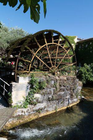 Water wheel on the city canal LIsle-sur-la-Sorgue Vaucluse France