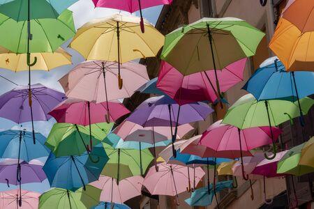 background with colored umbrellas on one street Reklamní fotografie