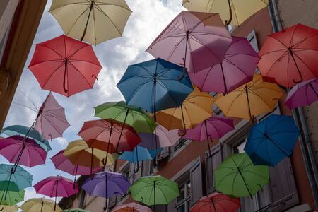 Street decorated colorful umbrellas outdoor background Stock Photo