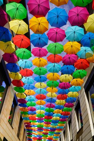 Artistic street decorated with colored umbrellas Stock Photo