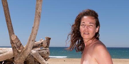 Beautiful woman on beach smiling in web banner header template Reklamní fotografie