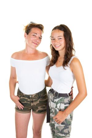 young teenager daughter posing with beautiful mother standing isolated over white background