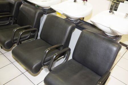 shampoo tray at the hairdresser row of hair washing sinks and chairs