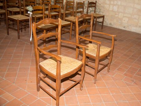 Empty bride groom chairs in church for weeding