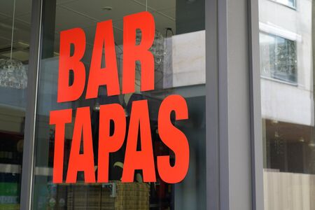 windows tapas bar sign restaurant on street