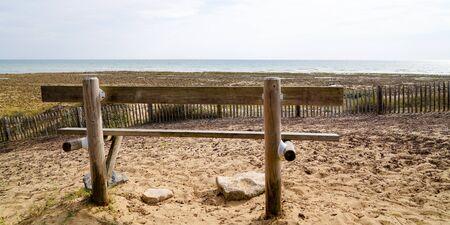 single wood bench empty in Atlantic coast in Jard sur Mer Vendée France in web banner template banner