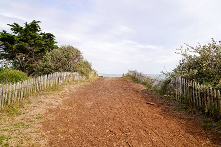 Fenced wood way to the beach in Saint Vincent sur Jard pathway access sea sand
