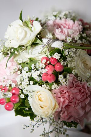 wedding fresh bunch of pink peonies and roses with marriage rings+ Stock Photo