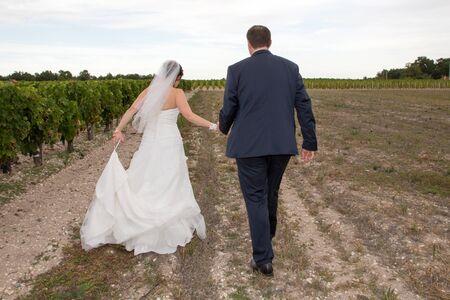 Bride and Groom Walking Away back couple marriage in vineyards