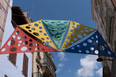colorful canvas stretched in the city