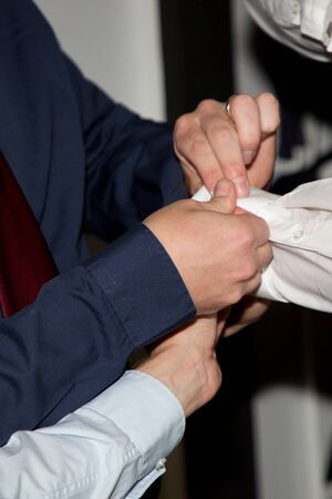 witness of the groom preparation shirts cufflinks Stock Photo