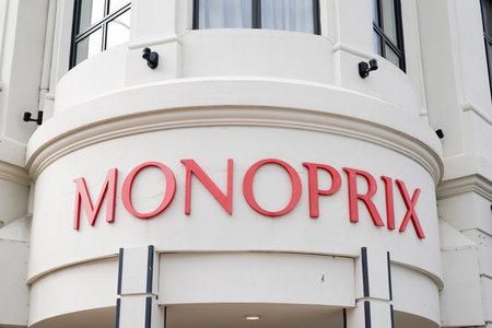 Arcachon , Aquitaine  France - 10 08 2019 : Closeup of Monoprix sign round building vintage on supermarket facade in the street Redactioneel