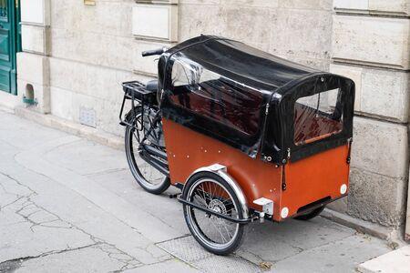 Typical cargo bike bicycle wooden basket modern fashion urban transportation Фото со стока