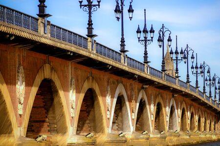 the pedestrian Pont de Pierre across the Garonne river in Bordeaux city