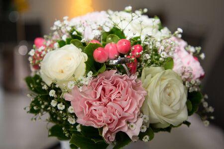 wedding bride groom rings in marriage flowers bouquet Stock Photo