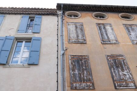wash cleaned house facade and a dirty one in a city center town