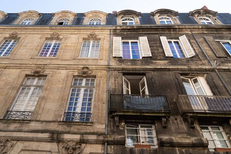 Difference between wash cleaned house building facade and dirty one before and after Stock fotó