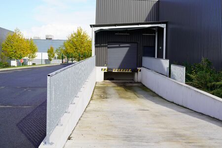 loading dock door for trucks delivery at warehouse