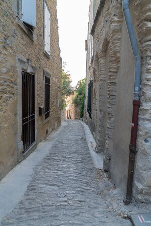 Gordes in the Luberon small cobbled stone alley Provence france