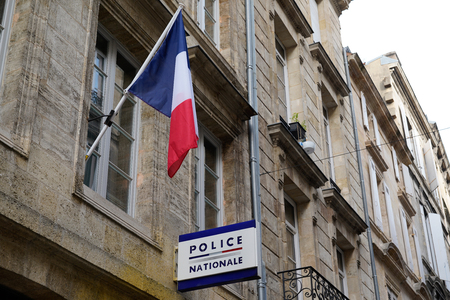 police nationale signpost indicating station sign with french flag building in street Redactioneel