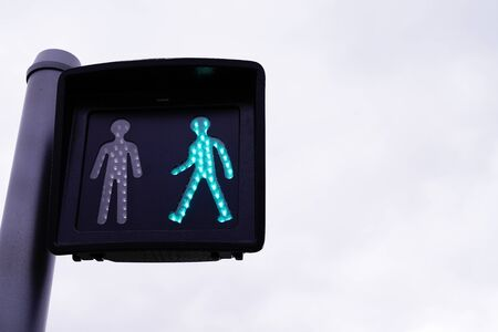 green traffic light signaling pedestrian crossing