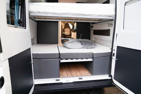 interior from camper van converted into vacation motorhome in show exhibition