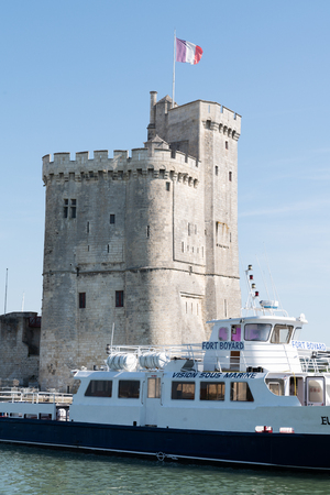La Rochelle , Aquitaine  France - 11 19 2019 :  view of Tour de la chaine with tourist boat go to fort boyard in La Rochelle France