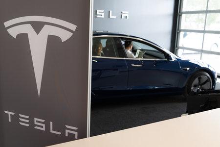 Bordeaux , Aquitaine  France - 11 18 2019 : Tesla car store customer delivery new model 3 inside dealership logo sign shop