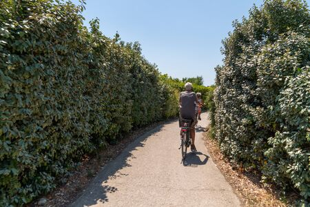 senior couple ride bike during vacation near La Rochelle city in Charente maritime France Фото со стока