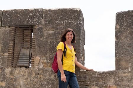 tourist vacation woman walking in the Carcassonne ancient medieval tower city
