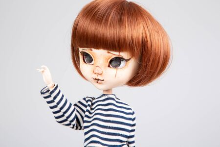 pretty doll red hairs hands up in white background