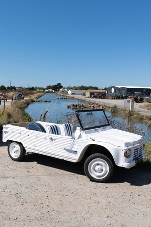 beach car vintage in salt marsh noirmoutier island france Stock Photo