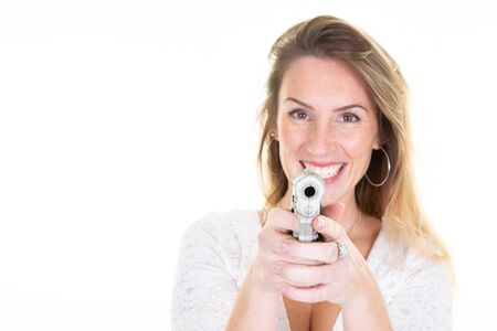 Blonde young woman with gun aside copy space on white background Imagens
