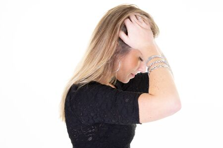 Young blonde woman long hair over isolated white background suffering from headache for having made reflexion business work effort