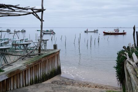 oysters beach and boat in the village of Arcachon in sunrise winter day Stock Photo
