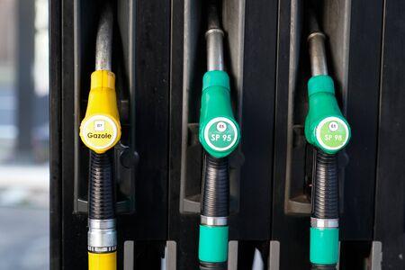 Fuel crane gaz equipment filling guns at the gas station Reklamní fotografie - 137090616