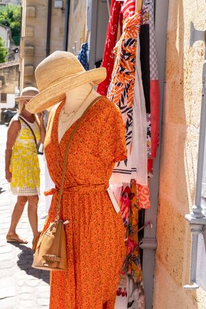 woman street shop clothing in summer day fashion 写真素材