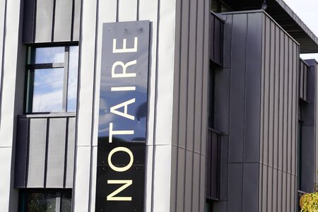 office entrance board notary in modern building french Notaire
