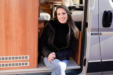 attractive young woman in her camper van rv lifestyle traveling around world in vanlife home motor Stock Photo